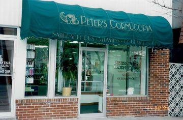 a picture of the outside of Peter's with the iconic awning